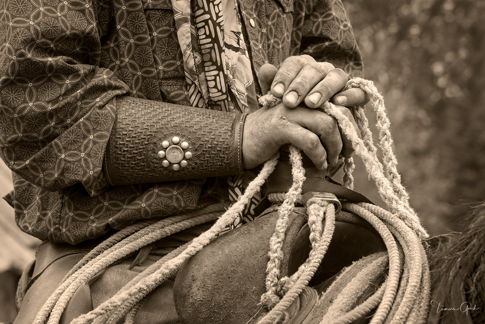 Cowboy Hardware is a limited edition print of 50 A sepia toned photograph of a cowboys hands, cuffs, rope and saddle is a perfect...